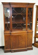 BERKEY & GAY MAHOGANY BREAKFRONT WITH FRETWORK DOORS AND CARVED MOLDING. 47 INCHES WIDE. 72 1/2 INCHES HIGH.