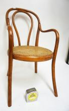 BENTWOOD CHILDS CHAIR WITH A CANE SEAT.