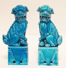 PAIR OF CERAMIC CHINESE FOO DOGS. 12 1/8 IN TALL.