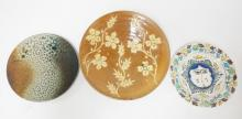 3 ART POTTERY PLATES. LARGEST IS 11 1/2 IN.