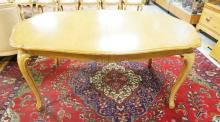 FRENCH DINING TABLE WITH A DISH TOP & 4 LEAVES MEASURING 14 3/4 IN EACH. TABLE TOP IS 67 1/2 IN X 44 1/2 IN.