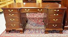 MAHOGANY 9 DRW KNEEHOLE DESK W/CARVED QUARTER
