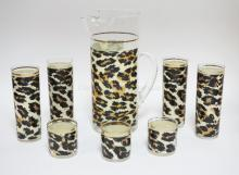8 PC MID CENTURY MODERN GLASSWARE W/ LEOPARD SKIN DESIGN. PITCHER- 11 1/4 IN, FOUR 6 3/4 IN TUMBLERS AND THREE 2 3/4 IN TUMBLERS