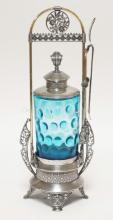VICTORIAN PICKLE CASTOR IN ORNATE MILLER SILVER PLATED FRAME W/ TONGS AND FORK. PRESSED BLUE ITP INSERT. 14 1/2 IN H