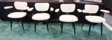 5 PC MODERN DINETTE SET. 41 3/4 IN ROUND FORMICA TOP TABLE AND 4 WOOD AND VINYL ARM CHAIRS. BLACK AND WHITE.