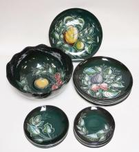 23 PC SASCHA BRASTOFF DINNERWARE W/ FRUIT AND LEAF DESIGN ON A DARK GREEN GROUND. BOWL IS 13 IN DIA, PLATES ARE 11 3/4 IN