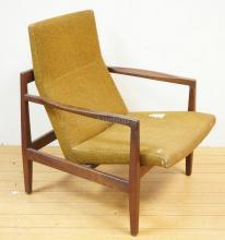 DANISH MODERN ARMCHAIR WITH *MARSH & MCLENNEN* LABEL. UPHOLSTERY TORN. 34 IN TALL.