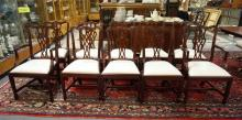 SET OF 10 CARVED MAHOGANY DINING CHAIRS. 38 IN TALL.