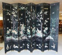 BLACK LACQUERED AND PAINT DECORATED ASIAN FOLDING SCREEN. 8 PANELS, EACH MEASURING 16 INCHES WIDE AND 95 INCHES HIGH.
