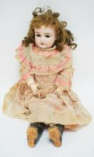 ANTIQUE BISQUE HEAD DOLL. NAME NOT LEGIBLE NO 129  24 IN