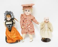 GROUP OF 3 BISQUE HEAD DOLLS. LARGEST IS A&M, 11 IN