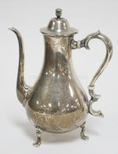 STERLING SILVER FTD. TEA POT. 8 IN H.  15.66 T OZ.  TOP OF HANDLE LOOSE WHERE ATTACHED. MONOGRAMMED.