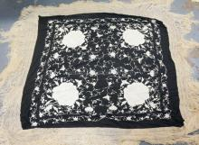 BLACK AND WHITE EMBROIDERED TABLE COVER W/ ROSES AND BUTTERFLIES. CROCHETED AND FRINGE BORDER. APP 45 IN SQUARE