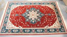 BURGUNDY AND GREEN ORIENTAL RUG. 5 FT 9 IN X 8 FT 8 IN