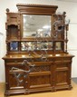 MASSIVE CARVED WALNUT VICTORIAN SIDEBOARD; 4 BEVELLED MIRROR BACK, BURL PANELS; 3 DRW, 3 DR; 72 IN WIDE, 95 IN HIGH, 25 IN DEEP