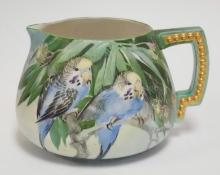 AMERICAN BELLEEK CIDER PITCHER HAND PAINTED WITH PARAKEETS. CERAMIC ARTS COMPANY MARK. 5 5/8 IN TALL. ARTIST SIGNED.