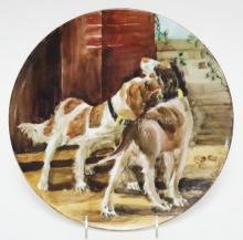 T&V LIMOGES HAND PAINTED PLAQUE OF 2 DOGS. 11 1/2 IN DIAMETER.