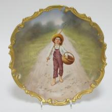 BLAKEMAN AND HENDERSON LIMOGES HAND PAINTED WALL PLATE. BOY WITH A FISHING POLE AND A BASKET WALKING DOWN A COUNTRY PATH. ARTIST SIGNED BAUMY. 12 1/2 IN