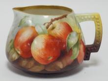 CERAMIC ARTS BELLEEK PORCELAIN CIDER PITCHER HAND PAINTED WITH APPLES. 5 1/2 IN HIGH.