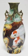 LARGE DECORATIVE PORCELAIN VASE HAND PAINTED WITH COY FISH. SIGNED ALZORA ZAREMBA. DRILLED HOLE IN BASE IS FILLED.