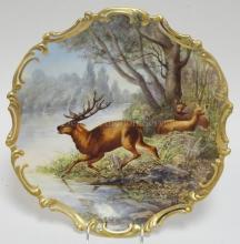 LIMOGES CHARGER HAND PAINTED WITH A STAG & 2 DOE. SIGNED T. GOLSE. 15 3/4 IN DIA.