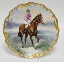 LIMOGES PORCELAIN CHARGER WITH A HAND PAINTED HORSE (SPEARMINT - 1906 WINNER OF THE GRAND PRIX OF PARIS) & JOCKEY. 13 1/2 IN WIDE. ARTIST SIGNED.