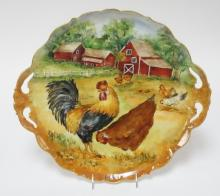 2 HANDLED LIMOGES TRAY HAND PAINTED WITH A FARM SCENE INCLUDING A ROOSTER, CHICKENS, AND BARNS. 16 IN HANDLE TO HANDLE. ARTIST SIGNED.