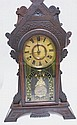 WALNUT VICTORIAN GINGERBREAD CLOCK W/REVERSE PTD