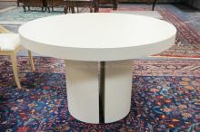 LINEN COVERED ROUND PEDESTAL TABLE IN THE MANNER OF KARL SPRINGER. 46 IN DIA, 30 IN H