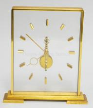 LE COULTRE INLINE DESK CLOCK, SKELETONIZED. MODEL 355. 7 3/4 IN H, 7 1/8 IN WIDE