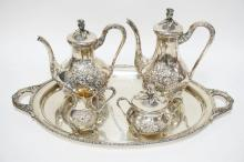 5 PIECE STERLING SILVER TEA & COFFEE SET DECORATED WITH REPOUSSE FLOWERS. EACH PIECE MARKED 925 STERLING AND *291*. 122.28 TROY OZ. THE TRAY MEASURES 23 X 13 7/8 INCHES AND THE TALLEST POT MEASURES 10 INCHES.