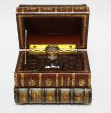 FRENCH LEATHER BOOK FORM CORDIAL SET WITH A THORENS MUSIC BOX. 7 X 5 AND 5 1/2 INCHES HIGH.