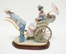 LLADRO *RICKSHAW RIDE* PORCELAIN FIGURE. 12 INCHES HIGH. 16 INCHES LONG. EXCELLENT CONDITION.