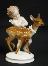 M.H. FRITZ FOR ROSENTHAL PORCELAIN FIGURE OF A CHILD WITH A SPOTTED FAWN. 6 INCHES HIGH.