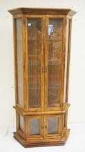 LIGHTED CURIO CABINET WITH GLASS SHELVES. 71 1/4 INCHES HIGH. 35 1/4 INCHES WIDE.
