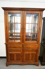 BROYHILL 2 PIECE CHINA CABINET WITH A LIGHTED INTERIOR, GLASS SHELVES, AND A MIRRORED BACK. 56 1/2 INCHES WIDE. 87 1/2 INCHES HIGH.