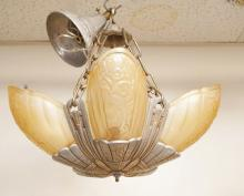ART DECO HANGING LIGHT WITH 5 FROSTED AMBER SHADES. MARKED *LINCOLN*. APPROX 16 INCHES IN DIA.