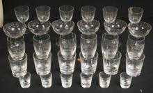 30 PIECE SET OF CUT CRYSTAL DRINKWARE. 6 PCS EACH OF 5 SIZES. TALLEST IS 4 3/4 INCHES. EACH GLASS CUT WITH VARIOUS ANIMALS INCLUDING BOARS, BUCKS, DOES, BIRDS, ETC.