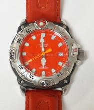 FESTINA WRIST WATCH WITH A RED LEATHER BAND AND FACE.