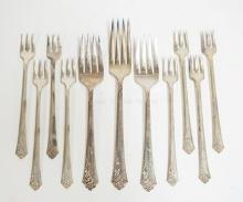 8.2 TROY OZ, 11 STERLING SILVER FORKS IN THE DEMASK ROSE PATTERN BY HEIRLOOM. LONGEST IS 7 1/8 INCHES.