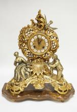 BRONZE MANTEL CLOCK WITH WHITE METAL FIGURES MOUNTED ON A MARBLE BASE. 19 1/2 INCHES HIGH.