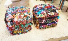PAIR OF MODERN OTTOMANS WITH COLORFUL FABRIC SCRAP UPHOLSTERY. APPROX 21 INCHES CUBED.