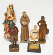 GROUP OF 5 GERMAN CARVED WOODEN FIGURES. TALLEST IS 8 3/4 INCHES.