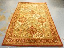 ORIENTAL RUG IN REDS & CREAMS. 7 FT 6 INCHES X 5 FT.
