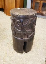 CARVED WOODEN STOOL. 18 1/2 INCHES HIGH. 10 1/2 INCHES WIDE.