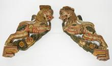 PAIR OF ASIAN CARVED AND POLYCHROME DECORATED WOODEN ARCHITECTURAL LIONS. APPROX 18 INCHES HIGH. EACH HAS PAINT LOSSES AND CHIPPING ON THE TOP AND BOTTOM PANELS.