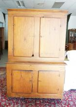4 DOOR COUNTRY STEPBACK CUPBOARD. 50 1/4 INCHES WIDE. 76 1/2 INCHES TALL. SOME LOSS TO THE CORNER OF ONE DOOR.