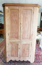 4 DOOR COUNTRY CORNER CUPBOARD. ONE PIECE. PANELED DOORS. APPROX 45 INCHES WIDE. 79 INCHES HIGH.