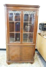 MAHOGANY CORNER CABINET WITH 2 GLASS DOORS ABOVE 2 BLIND DOORS. 71 INCHES HIGH. 38 INCHES WIDE.