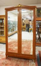 LOUIS XVI FRENCH STYLE ARMOIRE WITH MIRRORED DOORS AND PATTERNED VENEER. 50 INCHES WIDE. 89 INCHES HIGH.